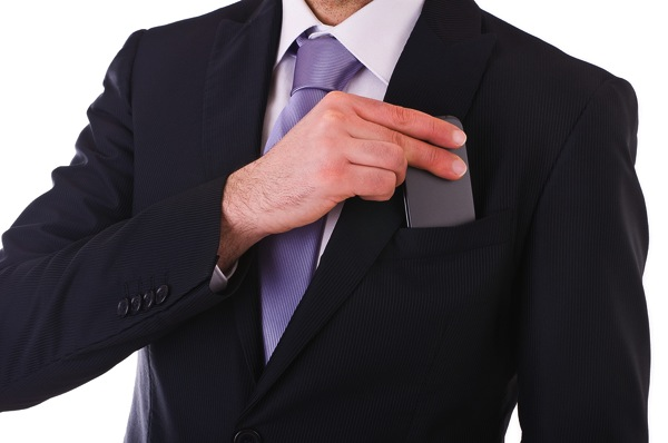 Bigstock Business man putting cellphone 43337023